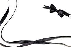 Black ribbon. And ribbon bow isolated on white background Royalty Free Stock Image