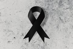 Black ribbon on the ground symbol. Of remembrance or mourning commemorate Stock Image
