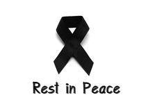Black ribbon for mourning with rest in peace text Stock Photo