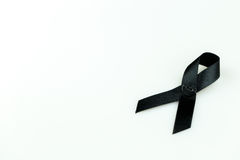 Black ribbon. Sign use for commemorate dead people,isolate on white background Royalty Free Stock Photo