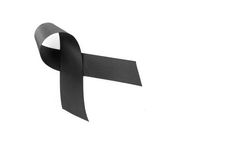 Black ribbon symbol for mourning Stock Images