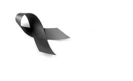 Black ribbon symbol for mourning Stock Photography