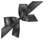 Black ribbon on white background. Royalty Free Stock Photo