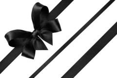 Free Black Ribbon With Gift Bow Isolated On White. Christmas Festive Bow Of Black Shiny Satin Ribbon And Diagonal Lines Of Royalty Free Stock Images - 161707949