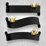 Black ribbons with gold crowns Royalty Free Stock Photography