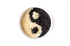 Black rice. Black and white rice forming a yin yang symbol Stock Photo