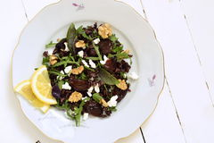 Black rice, arugula, sun-dried plums, walnuts and feta Royalty Free Stock Photo
