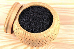 Black rice. In basket on table Stock Images