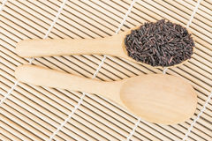 Black rice berry on wooden top view Royalty Free Stock Photo
