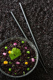 Black rice in a bowl and vegetables. On black rice backgroundnn Royalty Free Stock Photos