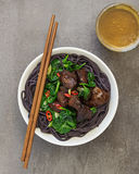 Black Rice Noodles with Pork and Spinach Royalty Free Stock Photos