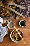 Black rice noodles with stir fried vegetables, soy sauce,dried c. Plan portrait view of stir fried vegetables with black rice noodles, served in a bowl Royalty Free Stock Photos