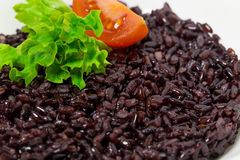 Black rice risotto with tomato. Royalty Free Stock Images