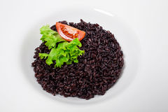 Black rice risotto with tomato. Stock Images
