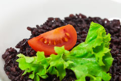 Black rice risotto with tomato. Stock Photography