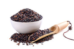 Black rice in round bowl Stock Images