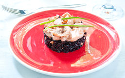 Black rice with salmon cream and parsley italy Royalty Free Stock Photos