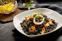 Black Rice and Seafood Dish with Lemon Wedges Stock Images