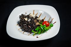 Black rice sensation. Black rice with tartufs and spicy ingredients Royalty Free Stock Photo