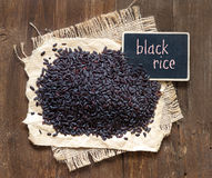 Black rice with small  chalkboard Stock Photography