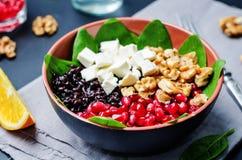 Black rice spinach feta pomegranate walnut salad with orange hon Stock Images