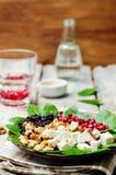 Black rice spinach feta pomegranate walnut salad with orange hon Royalty Free Stock Photo