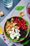 Black rice spinach feta pomegranate walnut salad with orange hon Royalty Free Stock Image
