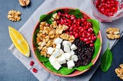 Black rice spinach feta pomegranate walnut salad with orange hon Royalty Free Stock Photography
