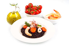 Black rice with squid , prawns and tomatoes Royalty Free Stock Photo