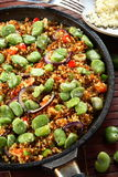 Black rice with vetiver and vegetables. On the frying pan Stock Image