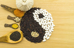 Black rice and white pill  forming a yin yang symbol  and Spa herbal Stock Photos