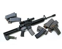 Black Rifle with Magazines Royalty Free Stock Photos