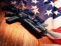 The Black Rifle And U.S. Flag. The Black Rifle with grenade launcher and U.S. flag Royalty Free Stock Images