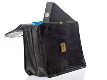Black ring binder in an open briefcase. Black file folder looking out of an open brieface (with a second folder inside). White label for copy Stock Image
