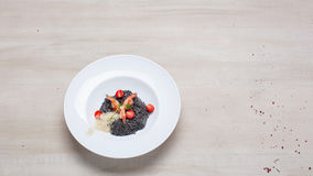 Black risotto with seafood Royalty Free Stock Photography