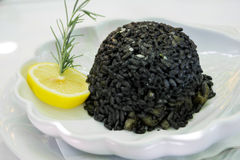 Black risotto and squid Stock Photography