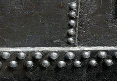 Black Rivet Joints. Rivet joints on black metal plates Royalty Free Stock Image