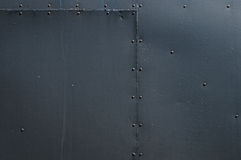 Black Riveted Sheet Metal Background Stock Photography