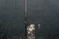 Black Riveted Sheet Metal Door Background Stock Photography