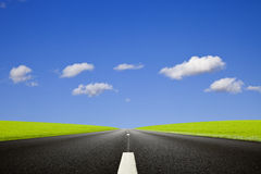 Black roadway against a deep blue sky Stock Photography