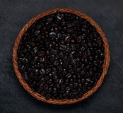 Black Roasted Coffee Beans on Dark Background royalty free stock photos