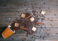 Black roasted coffee beans and grind with spices cinnamon, anise, cardamom, clove and brown sugar. With black vintage coffee grind Royalty Free Stock Photos