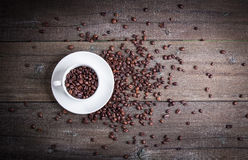 Black roasted coffee beans and grind with spices cinnamon, anise, cardamom, clove and brown sugar. With black vintage coffee grind Stock Images