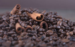 Black roasted coffee beans and grind with spices cinnamon, anise, cardamom, clove and brown sugar. With black vintage coffee grind Stock Photos