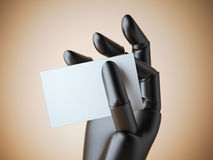 Black robot arm with blank business card Royalty Free Stock Photo