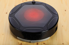 Black robot vacuum cleaner (isolated on 3 top quarter) Royalty Free Stock Photos