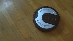 Black robotic vacuum cleaner. Black robotic vacuum cleaner on the floor stock video