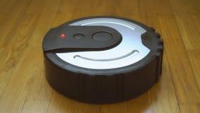 Black robotic vacuum cleaner. Black robotic vacuum cleaner on the floor stock footage