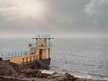 Free Black Rock Diving Tower, Salthill Beach, Galway Bay, Dramatic Stormy Sky Over The Ocean`s Water Stock Image - 160139861