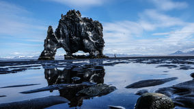 Black Rock Formation Near Body of Water during Daytime Stock Photo